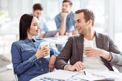 Nice colleagues drinking coffee Stock Photos