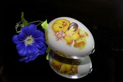 Nice colorful easter egg on the mirror royalty free stock photography