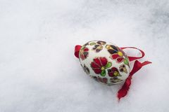 Nice colorful easter egg on the snow Stock Photos