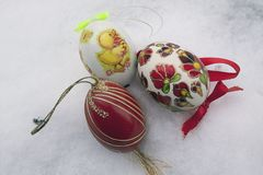 Nice colorful easter egg on the snow Royalty Free Stock Photography