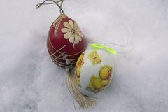 Nice colorful easter egg on the snow royalty free stock image