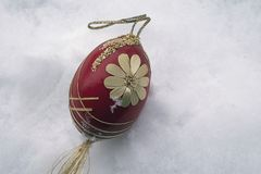 Nice colorful easter egg on the snow stock image