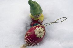 Nice colorful easter egg on the snow royalty free stock photo