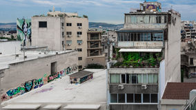 Nice colors in a dirty town. Graffiti and garden in the grey center of Athens Royalty Free Stock Photography