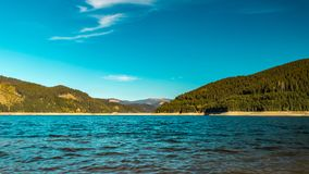 Nice colors lake and hills royalty free stock photos