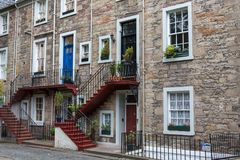 Nice colourful stairs to a front door at a stone house in Edinbu royalty free stock image