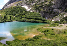 Nice colours of Fedaia Lake in Italian Dolomites Royalty Free Stock Photo