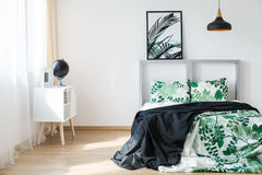 Nice comfy bedroom. Nice and comfy bed in bright modern bedroom Royalty Free Stock Photo