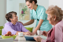 Nice conversation. Two older women having a nice conversation with young nurse Royalty Free Stock Photo