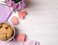 Nice cookies in the heart shape on a wooden table Royalty Free Stock Image