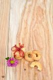 Nice cookies on wooden backdrop with ribbon and flower. Royalty Free Stock Image