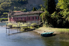 Nice corner in the lake. Wood quay and red house over the lake of como in italy Stock Images