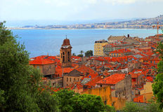 Nice, Cote d'Azur, France. Beautiful cityscape of Nice with old red roofs and blue sea, French Riviera, Cote d'Azur, France Stock Images