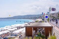 Beautiful daylight view to resort of Nice with a lot of umbrella stock images