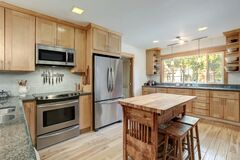 Nice country home wood kitchen with wooden island and ligth green tiles