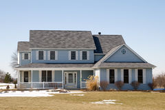 Nice Country House. A nice country house with blue siding photographed during winter season Royalty Free Stock Photo