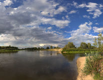 Nice country panorama with river, sheep and green field Royalty Free Stock Photos