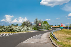 Nice country road with blue sky and white clouds Royalty Free Stock Photo