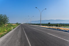 Nice country road with blue sky and white clouds background Royalty Free Stock Photos