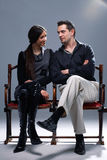 Nice Couple. Young couple sitting on a theatrical bench looking at each other Stock Photos