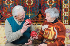 Nice couple. With two red ripe apple royalty free stock image