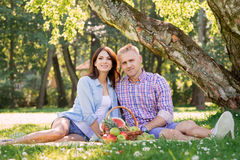 Nice couple having a great time in the park. Nice couple having a great time in the beautiful park Stock Photography