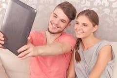 Nice couple holding laptop Royalty Free Stock Photos