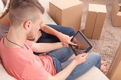 Nice couple holding laptop Stock Image