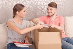 Nice couple opening boxes Stock Images