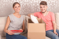Nice couple opening boxes Stock Photography
