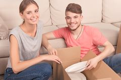 Nice couple opening boxes Stock Photo