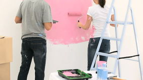Nice couple painting the wall together Stock Photography