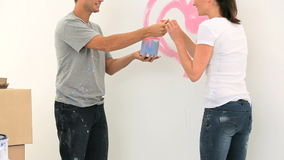 Nice couple paiting a wall Royalty Free Stock Images