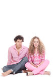 Nice couple sitting on the floor Stock Images