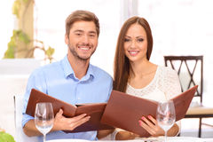 Nice couple sitting at the table Royalty Free Stock Photo