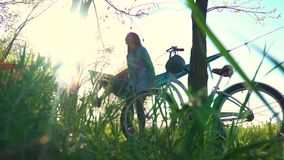 A couple after a bike ride sits down in a blue hammock, slow motion stock footage