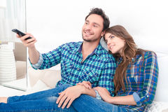 Nice couple watching TV Royalty Free Stock Photos
