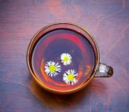 A nice cup  of tea with camomiles Royalty Free Stock Images