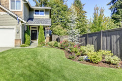Nice curb appeal of American brand-new house. Well kept front garden with perfect lawn and flower bed. Northwest, USA Stock Photo