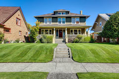 Nice curb appeal of American craftsman style house. Stock Photos