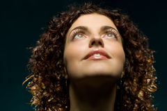 Nice curly girl. Is lookig up with smile Stock Images