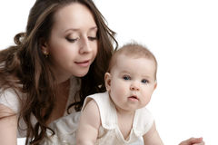 Nice dark-haired mother takes care of her child Stock Images