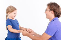 Nice daughter holding hands of father Stock Images