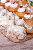 Catering food close up. Nice decorated catering on a wooden plate Stock Photo