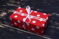 Nice designed polka dot gift box with white ribbon Stock Image