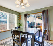 Nice dinning room with carpet and windows. Stock Photography
