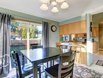 Nice dinning room with carpet and windows. Stock Photos