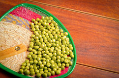 Nice display of many green lima beans. delicate layout over wooden surface Stock Image