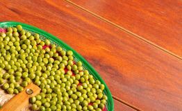Nice display of many green lima beans. delicate layout over wooden surface Royalty Free Stock Photos