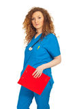 Nice doctor woman with clipboard Royalty Free Stock Image